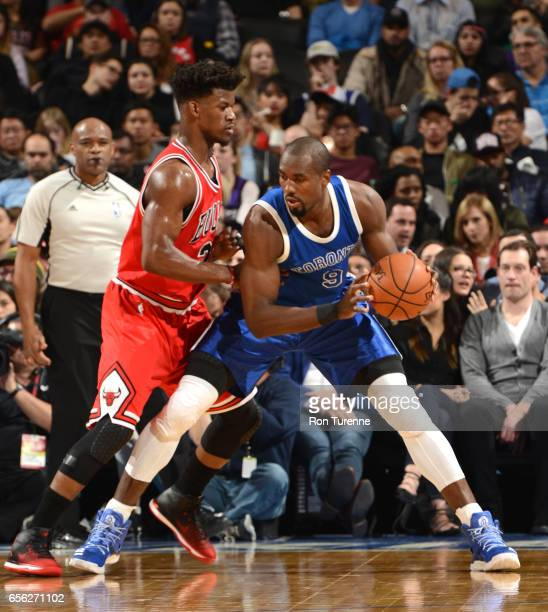 Serge Ibaka of the Toronto Raptors handles the ball against Jimmy Butler of the Chicago Bulls during the game on March 21 2017 at the Air Canada...