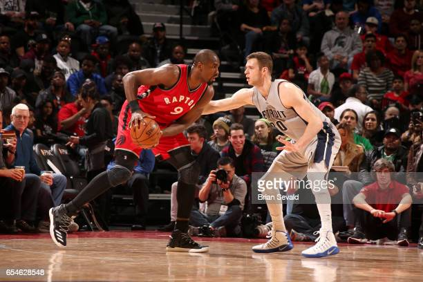 Serge Ibaka of the Toronto Raptors handles the ball against the Detroit Pistons on March 17 2017 at The Palace of Auburn Hills in Auburn Hills...