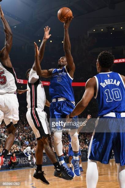 Serge Ibaka of the Toronto Raptors shoots the ball against the Miami Heat on April 7 2017 at the Air Canada Centre in Toronto Ontario Canada NOTE TO...