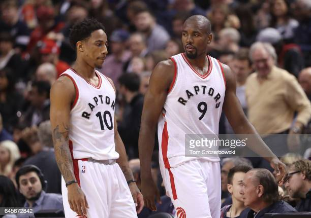 Serge Ibaka of the Toronto Raptors talks to DeMar DeRozan against the Portland Trail Blazers during NBA game action at Air Canada Centre on February...