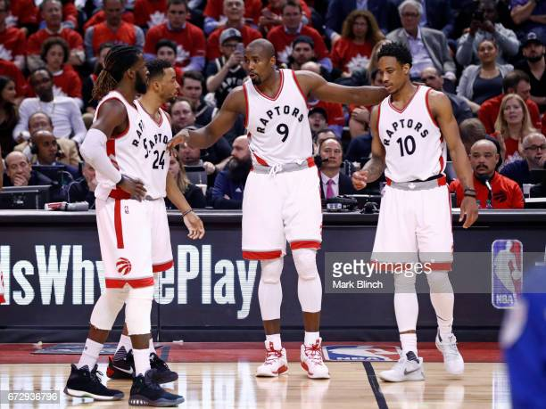 Serge Ibaka of the Toronto Raptors talks with his teammates during the game against the Milwaukee Bucks during Game Five of the Eastern Conference...
