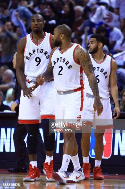 Serge Ibaka PJ Tucker and Cory Joseph of the Toronto Raptors return to the court during the first half of Game Four of the Eastern Conference...