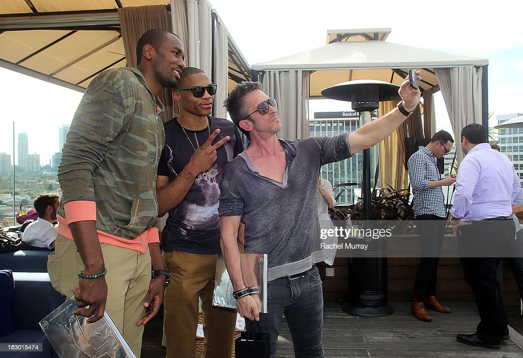 Serge Ibaka, Russell Westbrook, and Davis Factor attend Flaunt Magazine and Samsung Galaxy celebrate The Plutocracy Issue release hosted by cover Russell Westbrook at Caulfield's Bar and Dining Room at Thompson Hotel on March 2, 2013 in Beverly Hills, California.