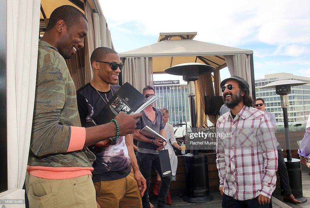 Serge Ibaka, Russell Westbrook, and Mr Brainwash attend Flaunt Magazine and Samsung Galaxy celebrate The Plutocracy Issue release hosted by cover Russell Westbrook at Caulfield's Bar and Dining Room at Thompson Hotel on March 2, 2013 in Beverly Hills, California.