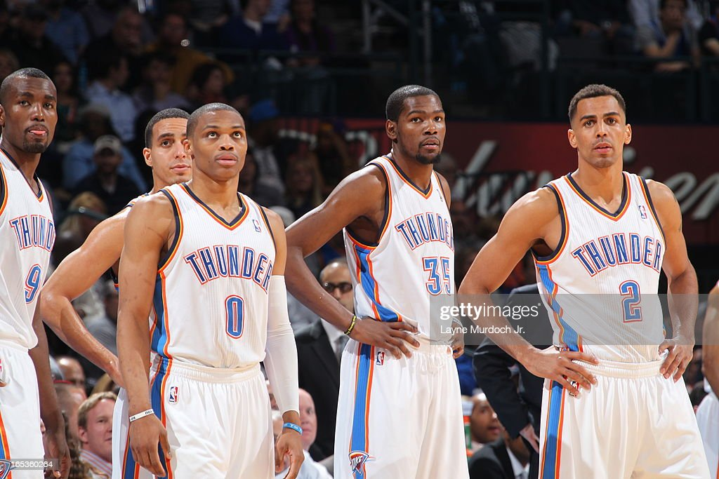 <a gi-track='captionPersonalityLinkClicked' href=/galleries/search?phrase=Serge+Ibaka&family=editorial&specificpeople=5133378 ng-click='$event.stopPropagation()'>Serge Ibaka</a> #9, <a gi-track='captionPersonalityLinkClicked' href=/galleries/search?phrase=Russell+Westbrook&family=editorial&specificpeople=4044231 ng-click='$event.stopPropagation()'>Russell Westbrook</a> #0, <a gi-track='captionPersonalityLinkClicked' href=/galleries/search?phrase=Kevin+Durant&family=editorial&specificpeople=3847329 ng-click='$event.stopPropagation()'>Kevin Durant</a> #35 and <a gi-track='captionPersonalityLinkClicked' href=/galleries/search?phrase=Thabo+Sefolosha&family=editorial&specificpeople=587449 ng-click='$event.stopPropagation()'>Thabo Sefolosha</a> #2 of the Oklahoma City Thunder stand on the court before the game against the Los Angeles Lakers on March 05, 2013 at the Chesapeake Energy Arena in Oklahoma City, Oklahoma.