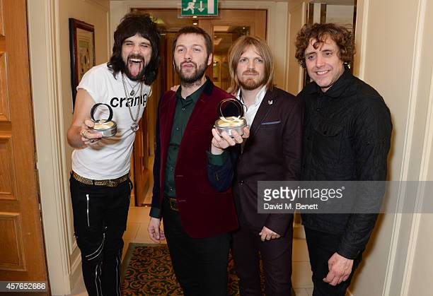 Serge Pizzorno Tom Meighan Chris Edwards and Ian Matthews of Kasabian winners of the Best Act In The World Today award pose in the press room at the...