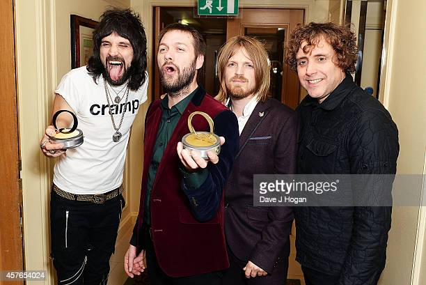 Serge Pizzorno Tom Meighan Chris Edwards and Ian Matthews of Kasabian winners of the Best Act In The World Today award at the Xperia Access Q Awards...