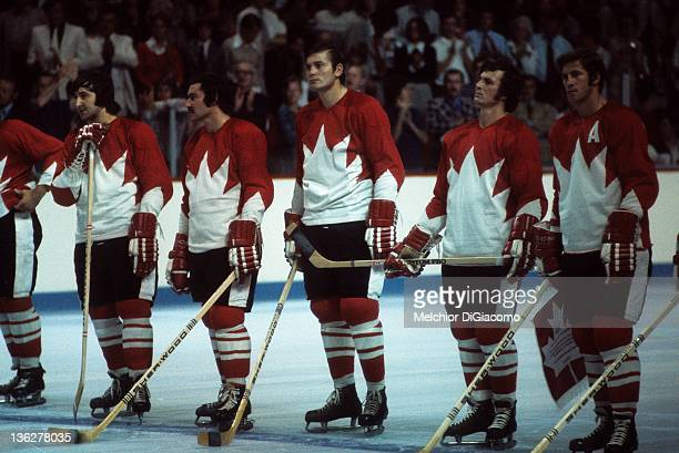 Serge Savard Mickey Redmond Pete Mahovlich Paul Henderson and Jean Ratelle of Canada stand on the ice during introductions before Game 1 of the 1972...