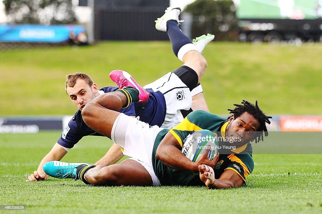 <a gi-track='captionPersonalityLinkClicked' href=/galleries/search?phrase=Sergeal+Petersen&family=editorial&specificpeople=10508841 ng-click='$event.stopPropagation()'>Sergeal Petersen</a> of South Africa Scores a try against Sam Pecquer of Scotland. during the 2014 Junior World Championships match between South Africa and Scotland at QBE Stadium on June 2, 2014 in Auckland, New Zealand.