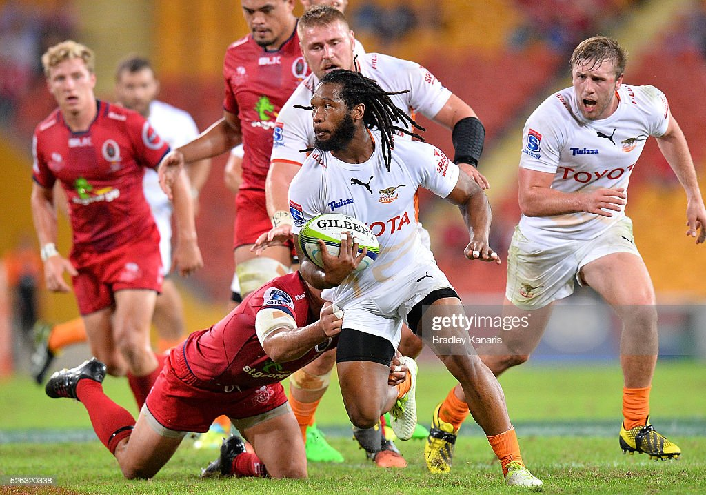 Sergeal Petersen of the Cheetahs is tackled during the round 10 Super Rugby match between the Reds and the Cheetahs at Suncorp Stadium on April 30, 2016 in Brisbane, Australia.