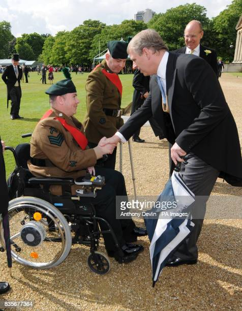 Sergeant Allie McKinney is greeted by Prince Andrew during the first Royal Garden Party of the summer at Buckingham Palace London