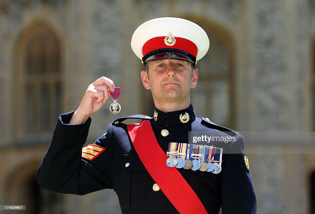 Sergeant Anthony Russell after he received the George Cross from Queen Elizabeth II during an Investiture ceremony at Windsor Castle on July 19, 2013 in Windsor, England.
