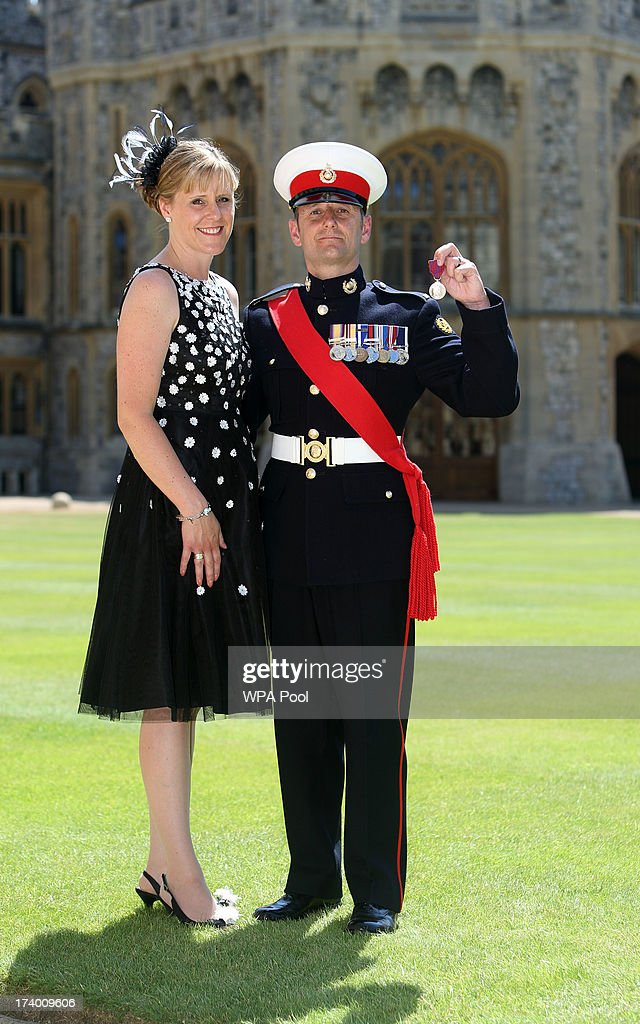 Sergeant Anthony Russell with wife Sharon after he received the George Cross from Queen Elizabeth II during an Investiture ceremony at Windsor Castle on July 19, 2013 in Windsor, England.