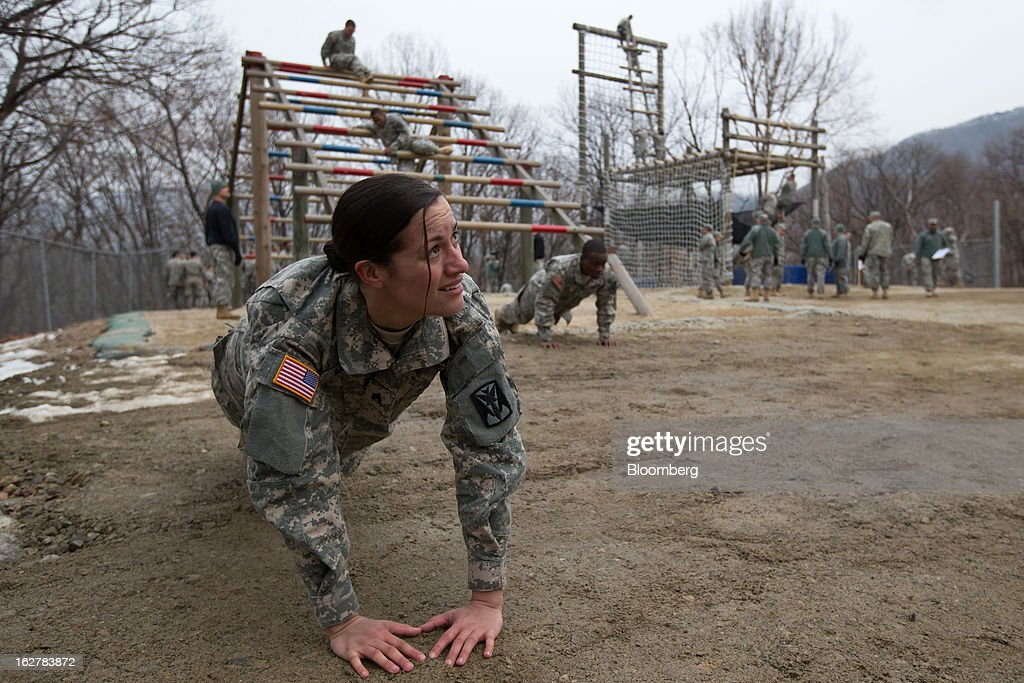 Sergeant Asyah Moore, a soldier with the U.S. Army's Second Infantry Division, does push-ups during an air assault training course at Camp Casey in Dongducheon, South Korea, on Tuesday, Feb. 26, 2013. The U.S. has 28,500 soldiers in South Korea as a legacy of the 1950-53 Korean War, which ended in a cease-fire that left the two Koreas technically still at war. Photographer: SeongJoon Cho/Bloomberg via Getty Images