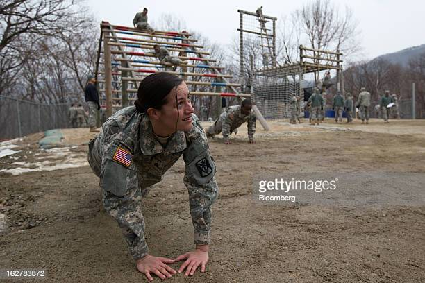 Sergeant Asyah Moore a soldier with the US Army's Second Infantry Division does pushups during an air assault training course at Camp Casey in...