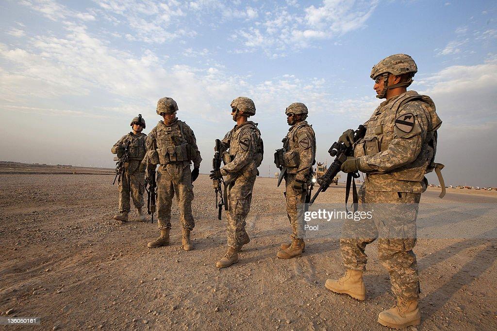 Sergeant Daniel Martin of the 3rd Brigade Combat Team 1st Cavalry Division checks the equipment of colleagues outside a Mine Resistant Ambush...
