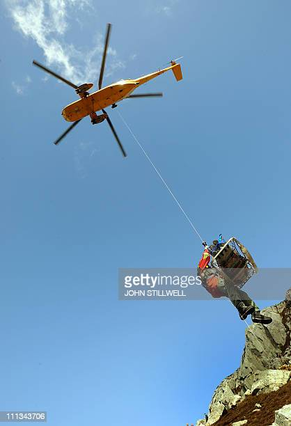 Sergeant Ed Griffith is lifted by a winch from a Sea King helicopter piloted by Britain's Prince William during a simulated rescue of a stranded...