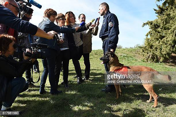 Sergeant Eric Tisserand answers journalists' questions after his Malinois named 'Choc' received the Honour medal of the French National Police on...