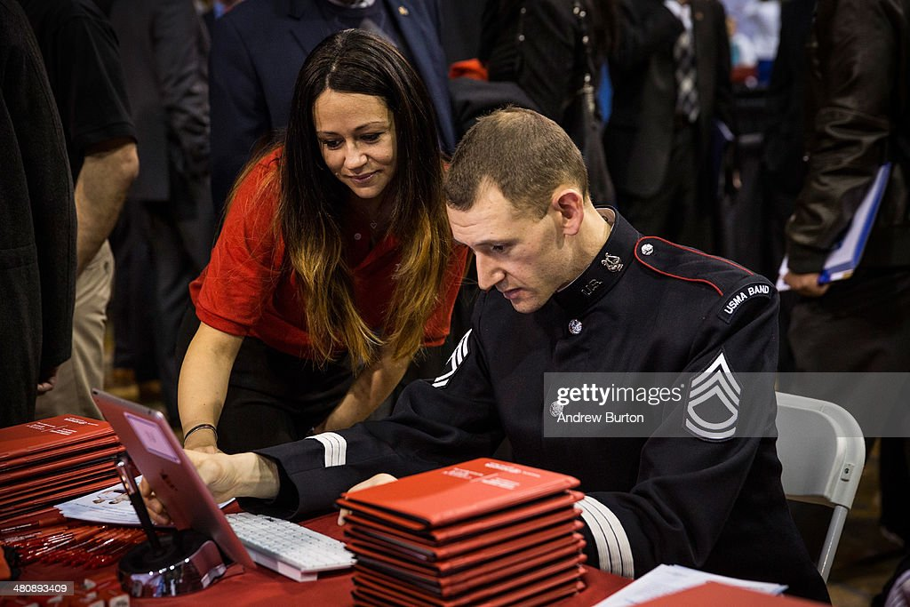 Sergeant First Class Sam Kaestner of the United States Army works with a Toyota recruiter at a 'Hiring our Heroes' Job Fair on March 27 2014 in New...