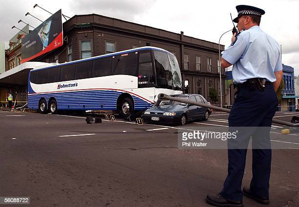 Sergeant Matt Rogers monitors the scene after a a bus lost control at the intersecton of Symonds St and Newton Rd plowing through traffic lights and...