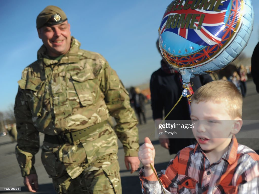 Sergeant Michael Thompson watches as his son, Charlie, 5, celebrates his return as soldiers from Headquarters Company 1st Battalion The Scots Guards return to their base at Bourlon Barracks and are reunited with their families following their recent deployment to Afghanistan on February 27, 2013 in Catterick, England. The soldiers are the first troops from 4 Mechanized Brigade to return to their base from their tour of duty in Afghanistan where they were responsible for the training and mentoring of the Afghan national security forces.