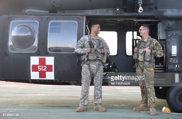 Sergeant Raymond Kea and Specialist Andrew Bolin of the 325th Aviation Regiment pose at the Williamson airfied in the Shoalwater Bay Training Area as...