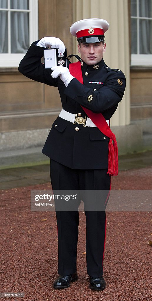 Sergeant Simon Wright-Hider, Royal Marines, poses after being awarded with the Conspicuos Gallantry Cross for services in Afghanistan , at Buckingham Palace on November 21, 2012 in London, England.