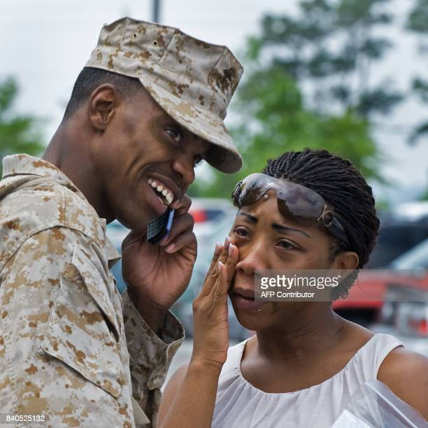 Sergeant spends his last minutes before leaving on the phone and with his girlfriend as he waits for a bus to arrive as approximately 100 members...
