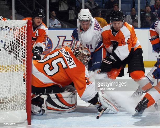 Sergei Bobrovsky and Kimmo Timonen of the Philadelphia Flyers stop John Tavares of the New York Islanders at the Nassau Coliseum on December 5 2010...