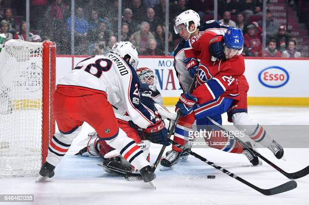 Sergei Bobrovsky and Oliver Bjorkstrand of the Columbus Blue Jackets defend the goal against Phillip Danault of the Montreal Canadiensin the NHL game...