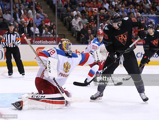Sergei Bobrovsky of Team Russia and Nathan MacKinnon of Team North America reach for a loose puck during the World Cup of Hockey 2016 at Air Canada...