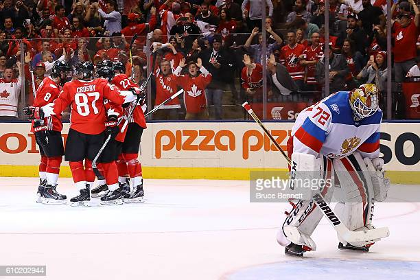 Sergei Bobrovsky of Team Russia reacts as Brad Marchand of Team Canada is congratulated by his teammates after scoring a second period goal at the...