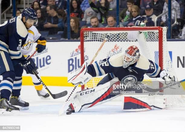 Sergei Bobrovsky of the Columbus Blue Jackets attempts to cover the puck during the second period of the game between the Columbus Blue Jackets and...