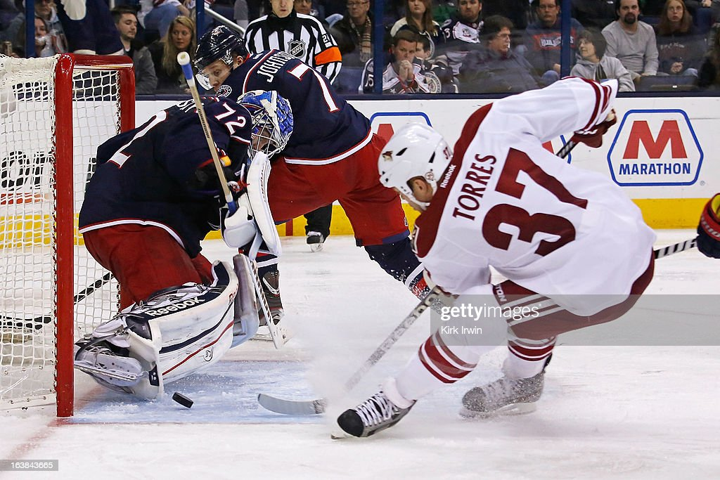 Sergei Bobrovsky #72 of the Columbus Blue Jackets blocks a shot from Raffi Torres #37 of the Phoenix Coyotes during the third period on March 16, 2013 at Nationwide Arena in Columbus, Ohio. Bobrovsky stopped 39 shots as Columbus defeated Phoenix 1-0 in a shootout.
