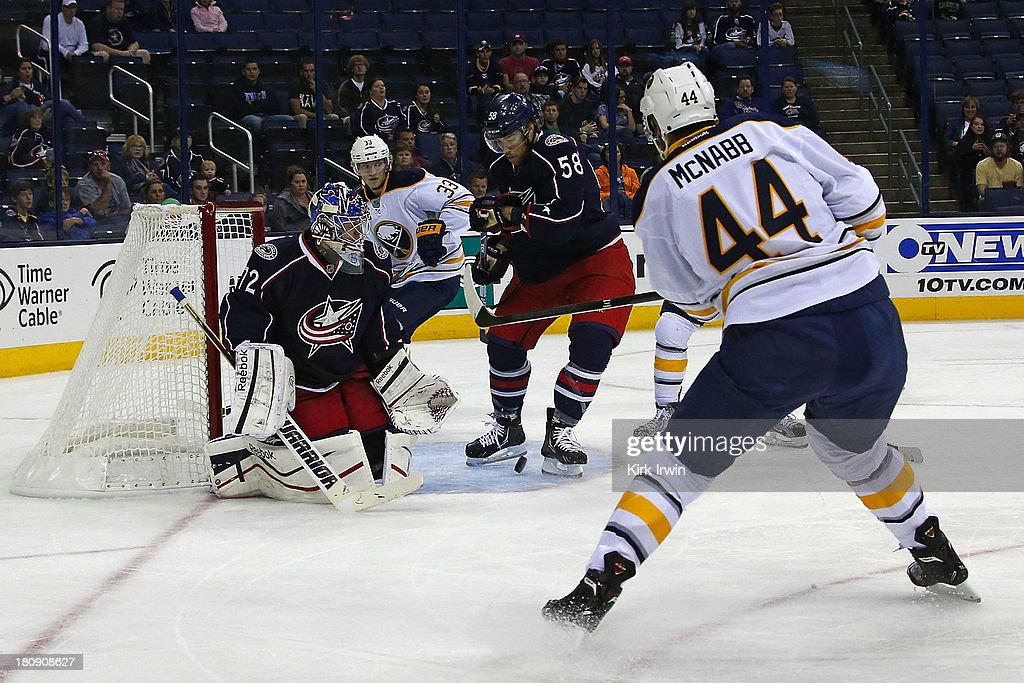 Sergei Bobrovsky #72 of the Columbus Blue Jackets blocks the net as David Savard #58 of the Columbus Blue Jackets stops a shot with his foot from Brayden McNabb #44 of the Buffalo Sabres during the first period on September, 2013 at Nationwide Arena in Columbus, Ohio.