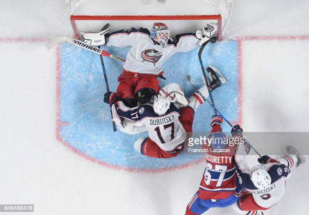 Sergei Bobrovsky of the Columbus Blue Jackets blocks the shot by Max Pacioretty of the Montreal Canadiens in the NHL game at the Bell Centre on...