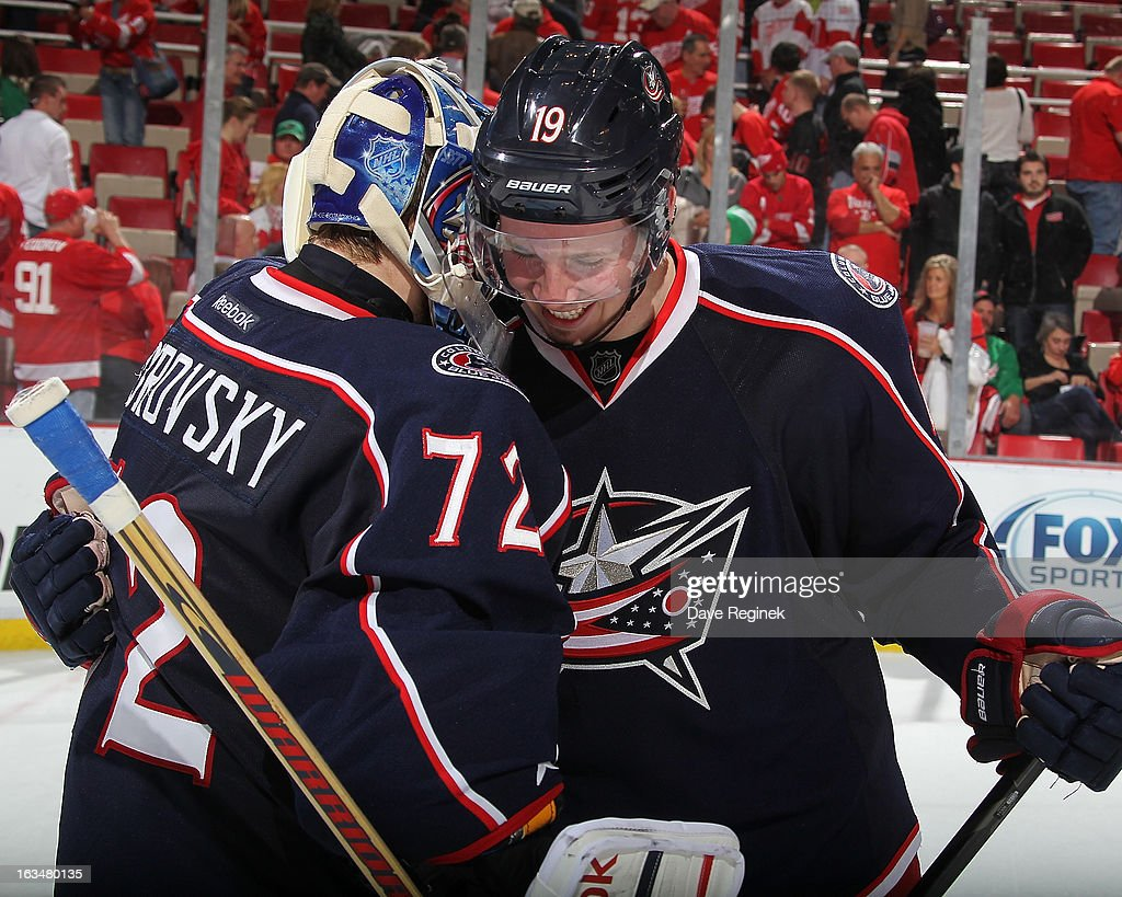 Sergei Bobrovsky #72 of the Columbus Blue Jackets celebrates a 3-2 shoot-out victory with teammate <a gi-track='captionPersonalityLinkClicked' href=/galleries/search?phrase=Ryan+Johansen&family=editorial&specificpeople=6698841 ng-click='$event.stopPropagation()'>Ryan Johansen</a> #19 after an NHL game against the Detroit Red Wings at Joe Louis Arena on March 10, 2013 in Detroit, Michigan.