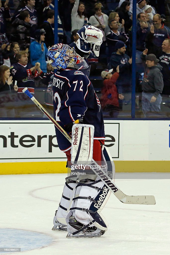 Sergei Bobrovsky #72 of the Columbus Blue Jackets celebrates after stopping 24 shots and leading Columbus to a 2-1 victory over the Dallas Stars on January 28, 2013 at Nationwide Arena in Columbus, Ohio.