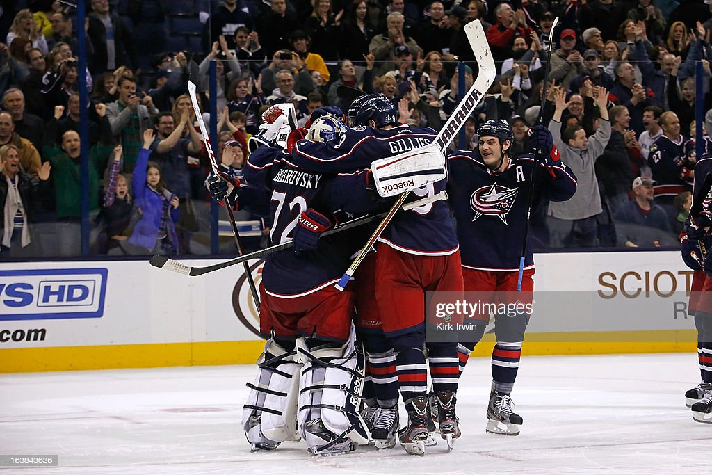 Sergei Bobrovsky #72 of the Columbus Blue Jackets celebrates with his teammates after making 39 saves as Columbus shut out the Phoenix Coyotes 1-0 in a shootout on March 16, 2013 at Nationwide Arena in Columbus, Ohio.