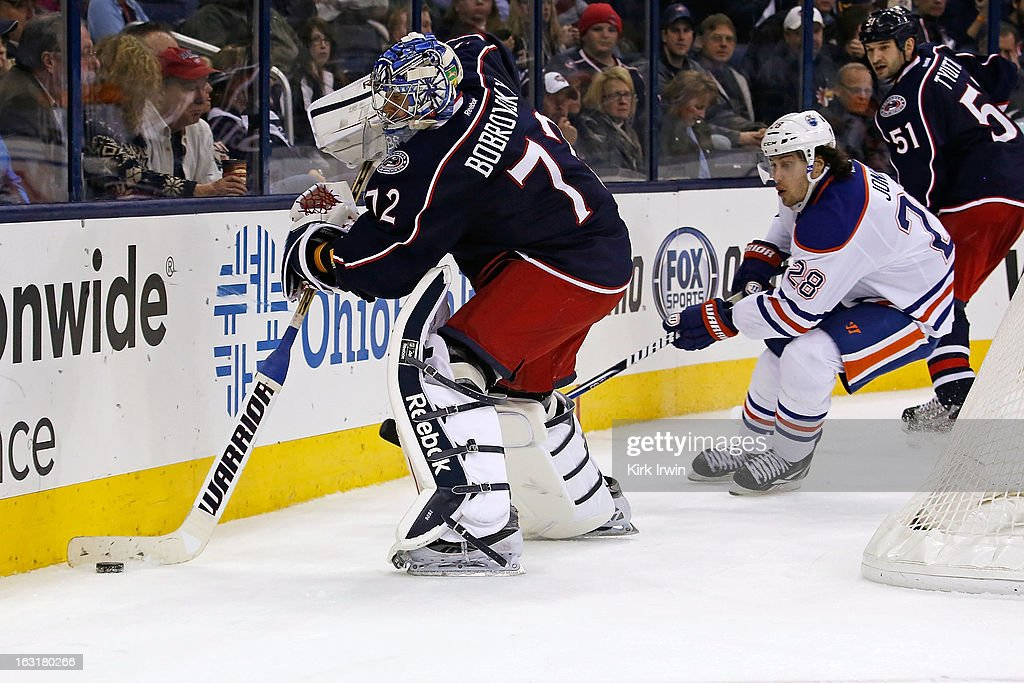 <a gi-track='captionPersonalityLinkClicked' href=/galleries/search?phrase=Sergei+Bobrovsky&family=editorial&specificpeople=4488556 ng-click='$event.stopPropagation()'>Sergei Bobrovsky</a> #72 of the Columbus Blue Jackets clears the puck away from Ryan Jones #28 of the Edmonton Oilers during the third period on March 5, 2013 at Nationwide Arena in Columbus, Ohio. Columbus defeated Edmonton 4-3 in a shootout.
