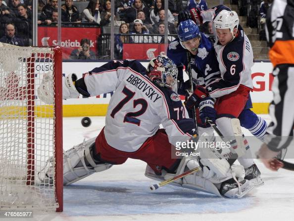 Sergei Bobrovsky of the Columbus Blue Jackets defends the goal as teammate Nikita Nikitin battles with James van Riemsdyk of the Toronto Maple Leafs...