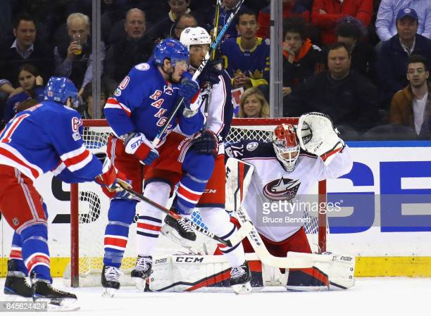 Sergei Bobrovsky of the Columbus Blue Jackets ducks as a shot by a New York Rangers player sails over his head during the first period at Madison...