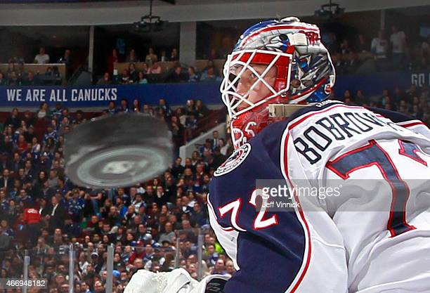 Sergei Bobrovsky of the Columbus Blue Jackets eyes the puck during their NHL game against the Vancouver Canucks at Rogers Arena March 19 2015 in...
