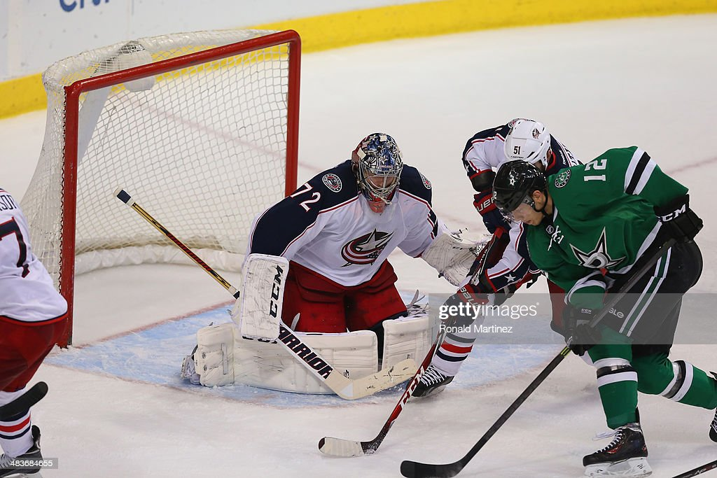 Sergei Bobrovsky #72 of the Columbus Blue Jackets in goal against Alex Chiasson #12 of the Dallas Stars in the third period at American Airlines Center on April 9, 2014 in Dallas, Texas.