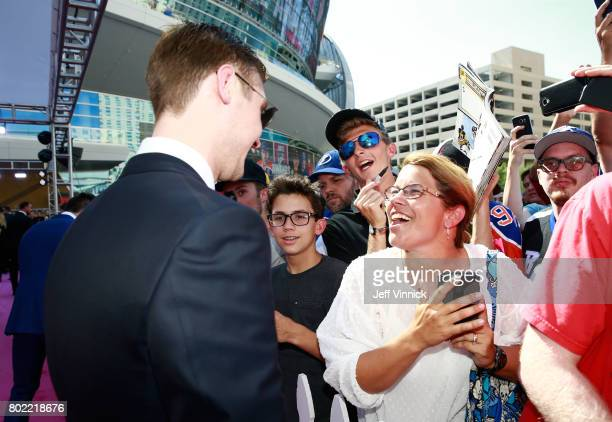 Sergei Bobrovsky of the Columbus Blue Jackets interacts with fans after posing for a selfie photo as he arrives on the magenta carpet for the 2017...