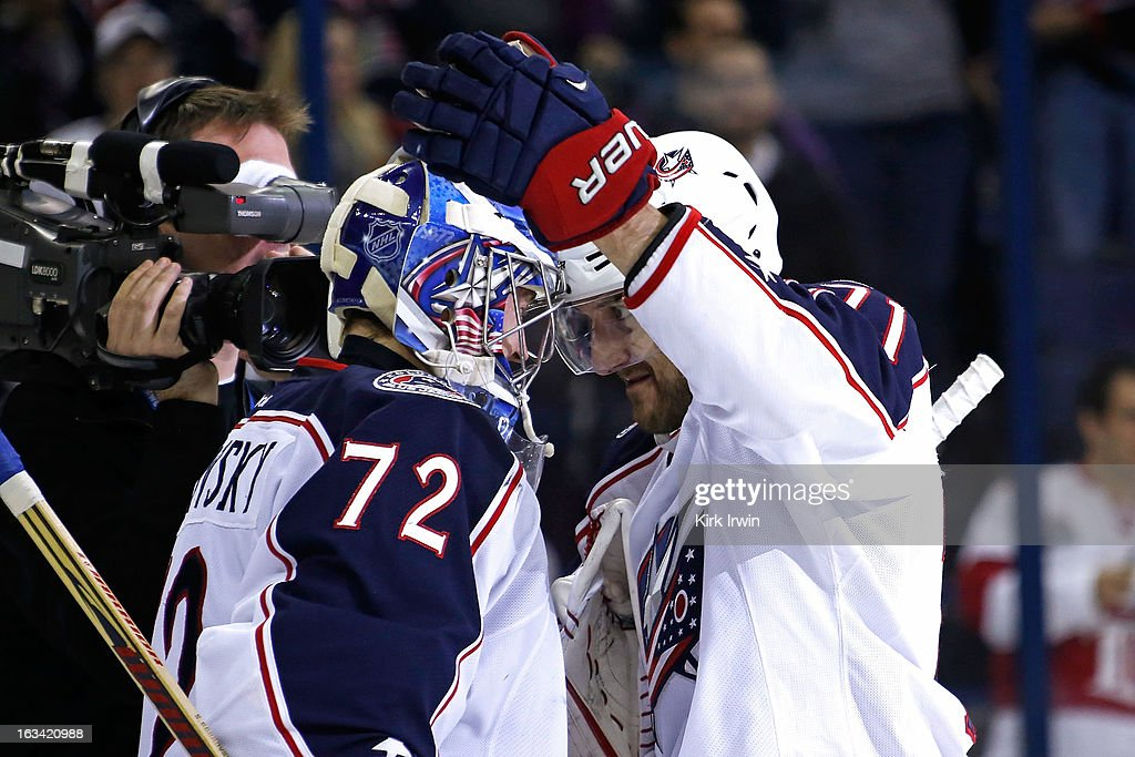 <a gi-track='captionPersonalityLinkClicked' href=/galleries/search?phrase=Sergei+Bobrovsky&family=editorial&specificpeople=4488556 ng-click='$event.stopPropagation()'>Sergei Bobrovsky</a> #72 of the Columbus Blue Jackets is congratulated by <a gi-track='captionPersonalityLinkClicked' href=/galleries/search?phrase=Nick+Foligno&family=editorial&specificpeople=537821 ng-click='$event.stopPropagation()'>Nick Foligno</a> #71 of the Columbus Blue Jackets after defeating the Detroit Red Wings 3-0 on March 9, 2013 at Nationwide Arena in Columbus, Ohio. Bobrovsky stopped all 30 shots from Detroit in Columbus' first shutout of the season.