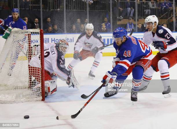 Sergei Bobrovsky of the Columbus Blue Jackets keeps an eye on Michael Grabner of the New York Rangers during the second period at Madison Square...