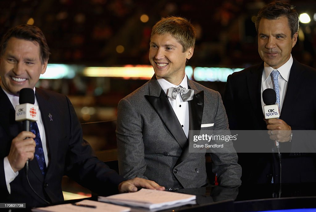 Sergei Bobrovsky of the Columbus Blue Jackets laughs with former NHL player Kelly Hrudey as Bobrovsky is interviewed with his translator after being presented with the Vezina Trophy for 2012-13 NHL season before Game Two of the 2013 Stanley Cup Final between the Chicago Blackhawks and the Boston Bruins at the United Center on June 15, 2013 in Chicago, Illinois.