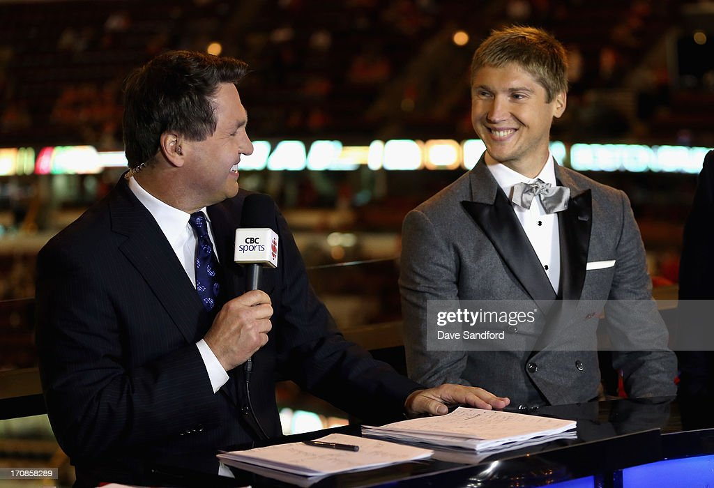 Sergei Bobrovsky of the Columbus Blue Jackets laughs with former NHL player Kelly Hrudey during an interview after being presented with the Vezina Trophy for 2012-13 NHL season before Game Two of the 2013 Stanley Cup Final between the Chicago Blackhawks and the Boston Bruins at the United Center on June 15, 2013 in Chicago, Illinois.