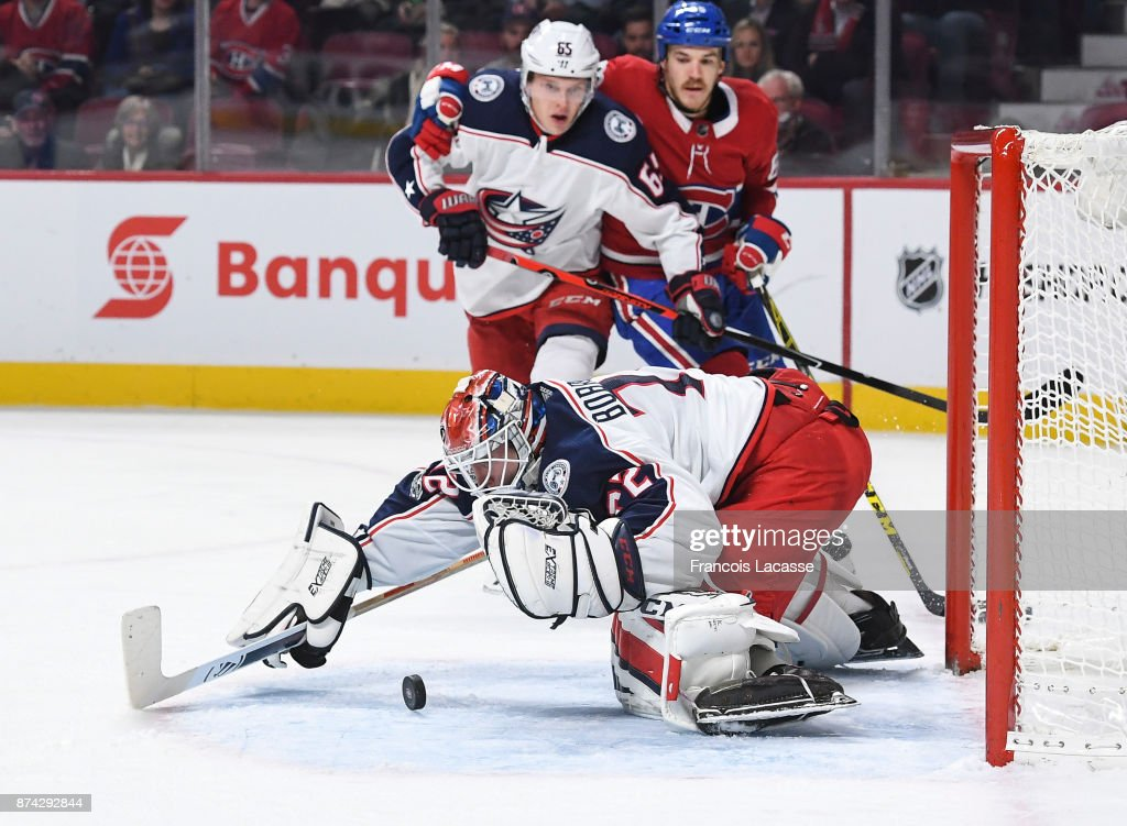 Sergei Bobrovsky #72 of the Columbus Blue Jackets looks a rebounding puck to cover it up against the Montreal Canadiens in the NHL game at the Bell Centre on November 14, 2017 in Montreal, Quebec, Canada.